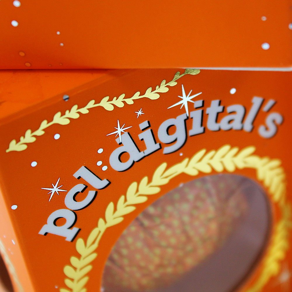 Close up of PCL Digital's Chocolate Orange Box, focussing on gold foil